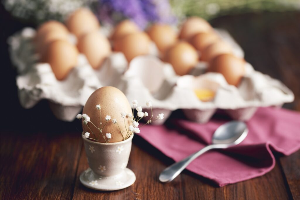 Boiled egg in egg cup for breakfast